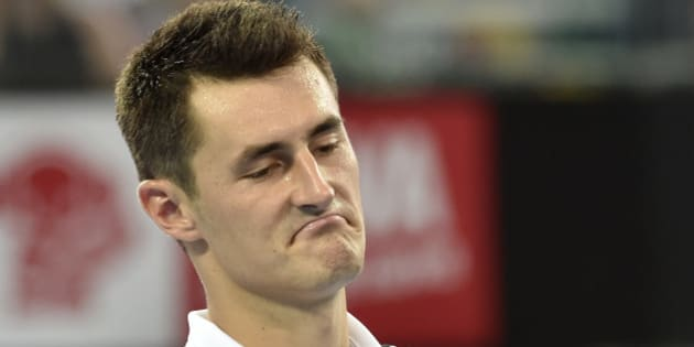 Australia's Bernard Tomic reacts after a point against Milos Raonic of Canada during their men's singles semi-final match on the seventh day of the Brisbane International tennis tournament on January 9, 2016. AFP PHOTO / Saeed KHAN -- IMAGE RESTRICTED TO EDITORIAL USE - STRICTLY NO COMMERCIAL USE / AFP / SAEED KHAN        (Photo credit should read SAEED KHAN/AFP/Getty Images)