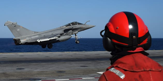 A French Rafale fighter aircraft carrying bombs is catapulted off French aircraft carrier Charles-de-Gaulle, on November 23, 2015 at eastern Mediterranean sea, as part of operation Chammal in Syria and Iraq against the Islamic State (IS) group. AFP PHOTO / ANNE-CHRISTINE POUJOULAT / AFP / ANNE-CHRISTINE POUJOULAT        (Photo credit should read ANNE-CHRISTINE POUJOULAT/AFP/Getty Images)