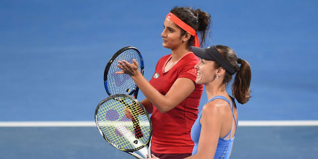 BRISBANE, AUSTRALIA - JANUARY 09:  Sania Mirza of India and Martina Hingis of Switzerland celebrate winning in the Women's Doubles Final against Angelique Kerber and Andrea Petkovic of Germany during day seven of the 2016 Brisbane International at Pat Rafter Arena on January 9, 2016 in Brisbane, Australia.  (Photo by Matt Roberts/Getty Images)