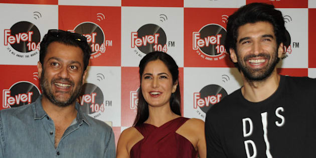 Indian Bollywood actors Katrina Kaif (C) and Aditya Roy Kapur (R) pose for a photograph during a promtional event for the forthcoming Hindi film 'Fitoor' directed by Abhishek Kapoor (L) in Mumbai on January 8, 2016. AFP PHOTO / STR / AFP / STRDEL        (Photo credit should read STRDEL/AFP/Getty Images)