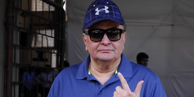 MUMBAI, INDIA  OCTOBER 15: Veteran actor Rishi Kapoor showing inked finger after casting vote for Maharashtra Assembly Elections 2014 polls at St. Annes School, Bandra on October 15, 2014 in Mumbai, India. A total of 56 per cent voters exercised their franchise in Maharashtra as polling to elect the new state government ended at 6 PM on Wednesday. The voter turnout was higher as compared to the last assembly elections. The five major parties of Maharashtra have a lot of stake in the State Assembly Elections. With the public of Maharashtra all geared up to vote for the 288-seat Maharashtra Assembly Elections, it will be interesting to see on whose side the people of Maharashtra vote for. (Photo by Prodip Guha/Hindustan Times via Getty Images)