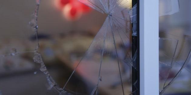 Close up of broken glass in window
