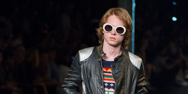 In this photo dated Sunday, June 28, 2015 Charlie Oldman, actor Gary Oldman's son, wears a creation at Saint Laurent's Spring-Summer 2015 Haute Couture fashion collection, presented in Paris, France. Pierce Brosnan and Gary Oldman attended the Saint Laurent Paris show — not as celebrity actors but as proud and genuinely nervous parents. Their sons, Dylan Brosnan and Charlie Oldman made their runway modeling debuts in the show after being discovered by designer Hedi Slimane. (AP Photo/Zacharie Scheurer)