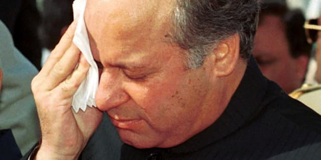 FILE-Nawaz Sharif, deposed prime minister of Pakistan, wipes his face in this August 14, 1999 file photo.  A special anti-terrorist court will hear charges of treason and kidnapping or hijacking against Sharif and seven others. If convicted they could be sentenced to life in prison or death. The charges were filed with police in the southern port city of Karachi on Thursday, Nov. 11, 1999. (AP Photo/Mian Khursheed)