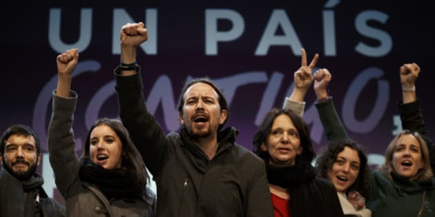 Podemos party leader Pablo Iglesias, center, and other party leaders celebrate following the latest official election results in Madrid, Monday, Dec. 21, 2015. Podemos supporters gathered outside their party headquarters in Madrid cheering as general election results began to roll in confirming the newcomer on the political scene looked set to capture 68 seats and a chance of forming a coalition in parliament.(AP Photo/Daniel Ochoa de Olza)