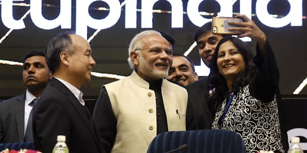 NEW DELHI, INDIA - JANUARY 16: Prime Minister Narendra Modi poses for a selfie with young founders of companies at the launch of Start-Up India at Vigyan Bhavan on January 16, 2016 in New Delhi, India. Indian Prime Minister launched a number of initiatives on Saturday to support the countrys start-ups, including a 100 billion rupee ($1.5 billion) fund and a string of tax breaks for both the companies and their investors. (Photo by Mohd Zakir/Hindustan Times via Getty Images)