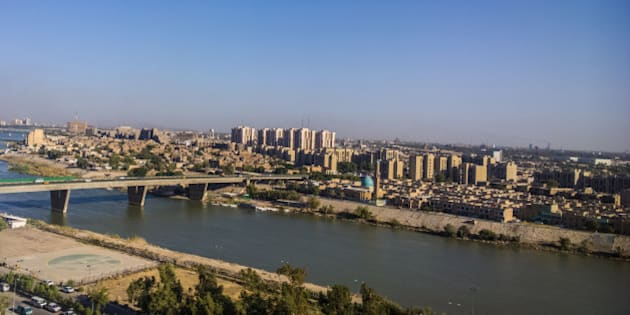 Aerial photographs of the city of Baghdad ,And shows where residential complexes and the Tigris River and bridges. The city of Baghdad, capital of Iraq, one of the oldest Arab capitals.