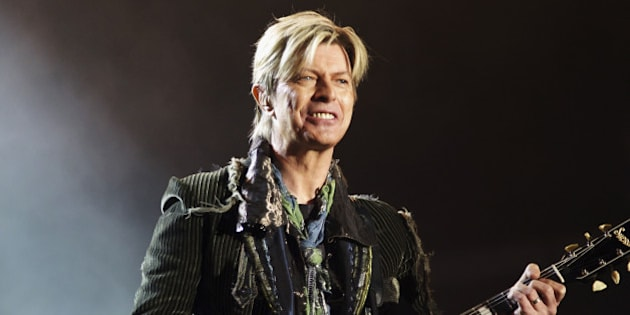 NEWPORT, ENGLAND - JUNE 13:  David Bowie performs on stage on the third and final day of 'The Nokia Isle of Wight Festival 2004' at Seaclose Park, on June 13, 2004 in Newport, UK. The third annual rock festival takes place during the Isle of Wight Festival which runs from June 4-19.  (Photo by Louise Wilson/Getty Images)