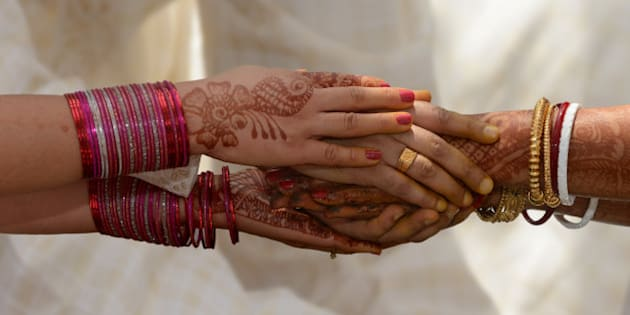 Holding hands during an Indian wedding, India.