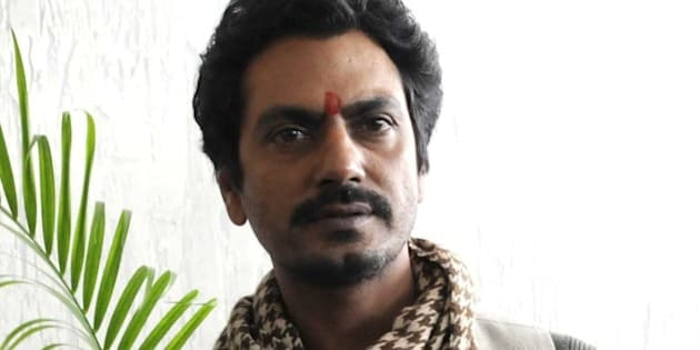 INDORE, INDIA - AUGUST 4: Bollywood actor Nawazuddin Siddiqui during the promotion of the upcoming movie 'Manjhi -The Mountain Man' on August 4, 2015 in Indore, India. The film directed Ketan Mehta and produced by Viacom 18 Motion Pictures, Maya Movies Pvt. Ltd. & NFDC. The film star cast Nawazuddin Siddiqui and Radhika Apte in the lead roles. The movie is based on the life of Dashrath Manjhi (Nawazuddin Siddiqui), who lived in Gehlaur village, near Gaya, in Bihar,  carved a road through a mountain in 22 years. The film is scheduled for release on August 21, 2015 in theaters. (Photo by Shankar Mourya/Hindustan Times via Getty Images)