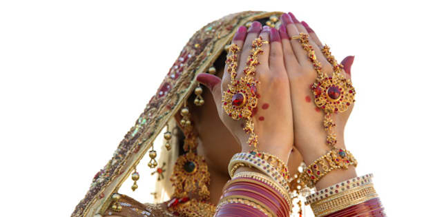 Beautiful Indian bride in traditional wedding dress and posing