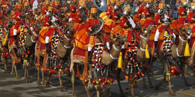 A camel mounted contingent of Border Security Force plays music during the final rehearsal of Republic Day parade in New Delhi, India, Monday, Jan. 23, 2012. (AP Photo/Saurabh Das)