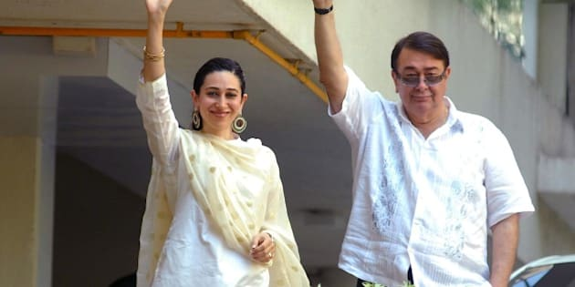 'MUMBAI, INDIA - OCTOBER 16: Randhir Kapoor and Karisma Kapoor appear on the balcony after the Saif-Kareena's registry marriage at Fortune Heights, Saif's residence in Bandra on October 16, 2012 in Mumbai, India. (Photo by Prodip Guha/Hindustan Times via Getty Images)'