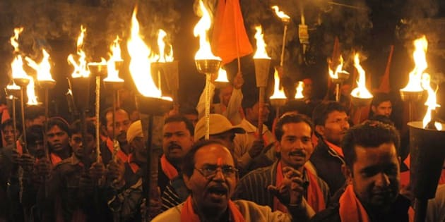 Indian activists of the Hindu Bajrang Dal Party hold torches during a procession marking the 22nd anniversary of the demolition of the Babri Masjid Mosque in Ayodhya, in Amritsar on December 6, 2014. Hindu hardliners demolished the Babri Mosque on December 6, 1992, claiming it was built on the site of the birth place of the Hindu God Ram, sparking off country wide Hindu-Muslim riots. AFP PHOTO / NARINDER NANU        (Photo credit should read NARINDER NANU/AFP/Getty Images)