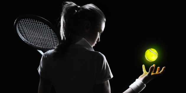 female tennis player holding a glowing ball