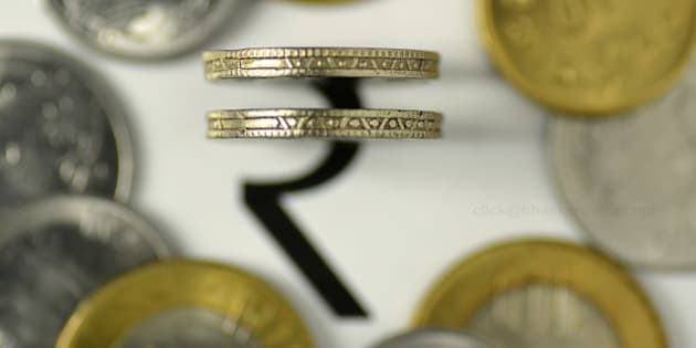 The rupee symbol with Indian coins currency.