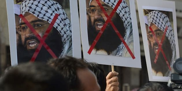 Indian activists carry placards of the chief of Jaish-e-Mohammad, Maulana Masood Azhar during a protest against the attack on the air force base in Pathankot, in Mumbai on January 4, 2016.  Indian troops backed by helicopters searched an air force base January 4, after a weekend of fierce fighting with suspected Islamic insurgents in which seven soldiers and at least four attackers were killed.    AFP PHOTO/ Indranil MUKHERJEE / AFP / INDRANIL MUKHERJEE        (Photo credit should read INDRANIL MUKHERJEE/AFP/Getty Images)