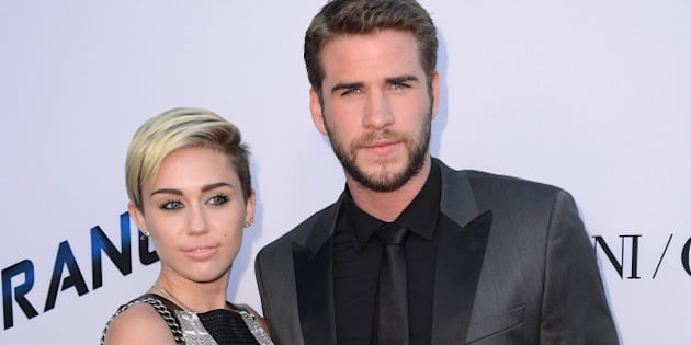 """Actor Liam Hemsworth, right, and singer Miley Cyrus arrive at the US premiere of """"Paranoia"""" at the DGA Theatre on Thursday, August 8, 2013 in Los Angeles. (Photo by Jordan Strauss/Invision/AP)"""