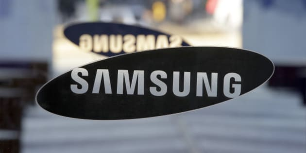 A logo of Samsung Electronics is seen at its showroom in Seoul, South Korea, Thursday, Jan. 8, 2015. Samsung Electronics Co. said Thursday its annual profit fell for the first time in three years as its smartphone growth lost steam. (AP Photo/Lee Jin-man)