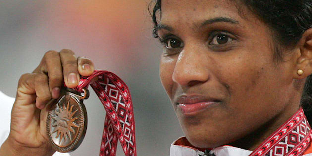 India's P. Jaisha Orchatteri holds the bronze medal for the final of the Women's 5000m at the Asian Games in Doha, Qatar, Monday Dec. 11, 2006.  (AP Photo/Junji Kurokawa)