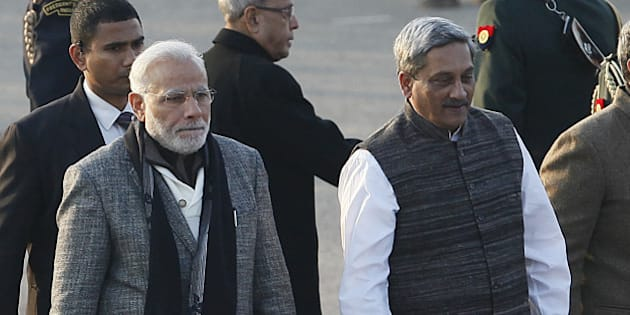 NEW DELHI, INDIA - JANUARY 29: Prime Minister Narendra Modi along with Defence Minister Manohar Parrikar, Minister of State for Defence Rao Inderjit Singh arrive for the Beating Retreat Ceremony at Vijay Chowk on January 29, 2015 in New Delhi, India. The ceremony is a culmination of Republic Day celebrations and dates back to the days when troops disengaged themselves from battle during sunset. (Photo by Raj K Raj/Hindustan Times via Getty Images)