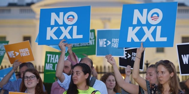 Activists, celebrating US President Barack Obama's blocking of the Keystone XL oil pipeline, rally in front of the White House in Washington, DC on November 6, 2015. US President Barack Obama blocked the Keystone XL oil pipeline that Canada sought to build into the United States, ruling it would harm the fight against climate change. AFP PHOTO/MANDEL NGAN        (Photo credit should read MANDEL NGAN/AFP/Getty Images)