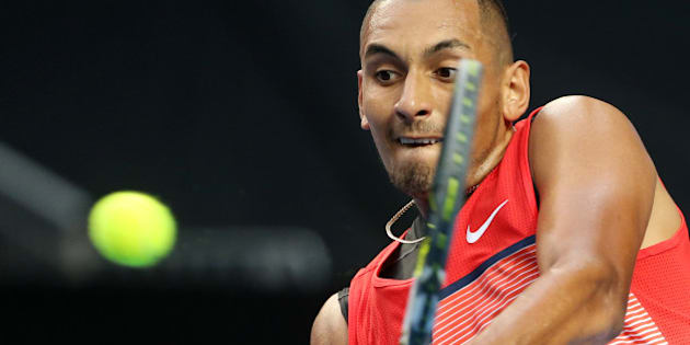 Nick Kyrgios of Australia makes a backhand return to Pablo Carreno Busta of Spain during their first round match at the Australian Open tennis championships in Melbourne, Australia, Monday, Jan. 18, 2016.(AP Photo/Rick Rycroft)