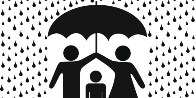 Parents protect child with umbrella in rain