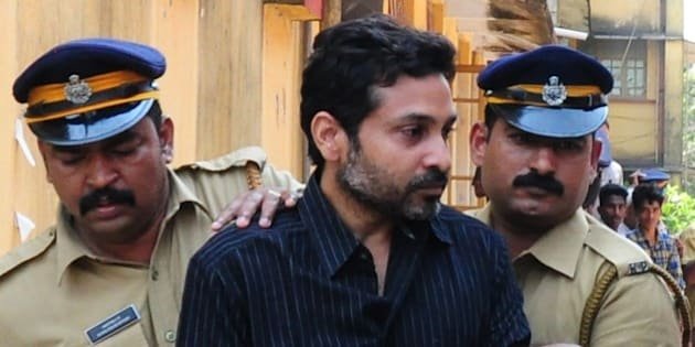 Indian police personnel escort murder suspect Muhammad Nisham (C), accused of fatally wounding a security guard by driving into him with his car, at the Judicial Magistrate's Court in Thrissur on March 11, 2015. Beedi tycoon Mohammed Nisham, accused of killing a security guard by driving into him with his SUV, was held March 9 under the state of Karala's Anti-Social Activities Act, under which he will be denied bail for at least six months. AFP PHOTO / STR        (Photo credit should read STRDEL/AFP/Getty Images)