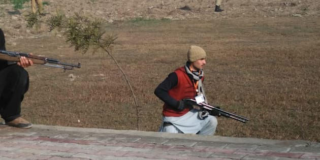 This photograph taken from a mobile phone shows Pakistani security personnel taking position outside the Bacha Khan university following an attack by gunmen in Charsadda, about 50 kilometres from Peshawar, on January 20, 2016. Gunmen have attacked a university in northwestern Pakistan, injuring at least three people, and are still on the rampage, security and school officials told AFP in the latest assault to hit the militant-infested region. AFP PHOTO / A MAJEED / AFP / A Majeed        (Photo credit should read A MAJEED/AFP/Getty Images)