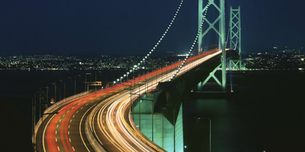 Japan, Hyogo Prefecture, Akashi, Awaji Island, Akashi Kaikyo Bridge, Bridge lit up at night