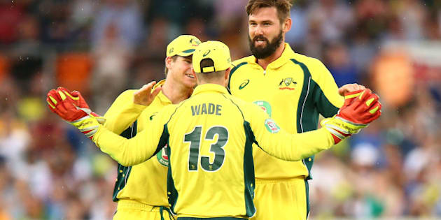 CANBERRA, AUSTRALIA - JANUARY 20:  Kane Richardson of Australia celebrates with team mates after taking a wicket during the Victoria Bitter One Day International match between Australia and India at Manuka Oval on January 20, 2016 in Canberra, Australia.  (Photo by Mark Nolan/Getty Images)