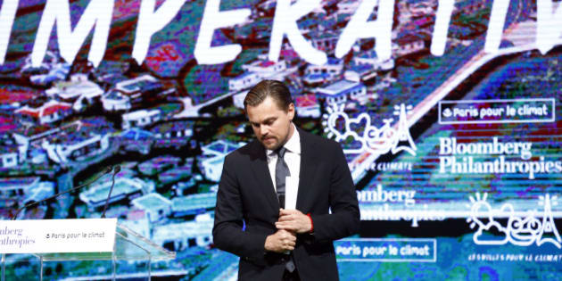 Leonardo DiCaprio walks out after his speech to the audience during a meeting with Mayors to push for local actions to fight climate change at Paris city Hall on the margins of the COP21, as part of the COP21, United Nations Climate Change Conference, in Paris, Friday, Dec. 4, 2015. (AP Photo/Francois Mori)
