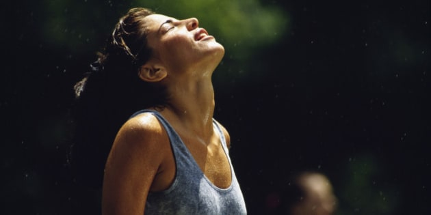 Exhausted runner drenched in sweat