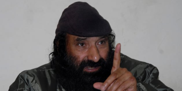 Syed Salahuddin, head of Kashmiri militant group Hizb-ul-Mujahedin, gestures during a press conference in Muzaffarabad on March 24, 2013. Salahuddin, accused Pakistan's former military ruler Pervez Musharraf of betrayal for signing a ceasefire deal with India in the divided Himalayan region during his rule.  AFP PHOTO/Sajjad QAYYUM        (Photo credit should read SAJJAD QAYYUM/AFP/Getty Images)