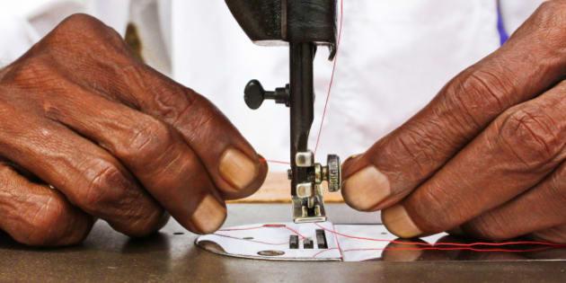 Man stitching.