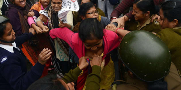 Leftist student activists tussle with police prior to getting arrested during a protest rally in Kolkata following the suicide of Rohit Vemula, a doctarate student at the Hyderabad Central University, on January 20, 2016. Rohit, a second-year PhD student of Life Sciences was found hanging in his hostel room after he was suspended from the college due to a political dispute. AFP PHOTO/DIBYANGSHU SARKAR / AFP / DIBYANGSHU SARKAR        (Photo credit should read DIBYANGSHU SARKAR/AFP/Getty Images)