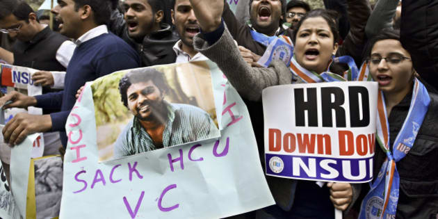 NEW DELHI, INDIA - JANUARY 19: NSUI students shout slogans against Union Minister Bandaru Dattatreya during a protest against the suicide of Research scholar Rohit Vemula in front of HRD Minister Office at Shastri Bhawan on January 19, 2016 in New Delhi, India. 26-year-old Vemula, a second-year research scholar of science, technology and society studies department at Hyderabad University, was found hanging in his friend's hostel room on Sunday night. He, along with four Dalit research scholars, was expelled from the University of Hyderabad 12 days ago over alleged fight with another student group. (Photo by Arun Sharma/Hindustan Times via Getty Images)