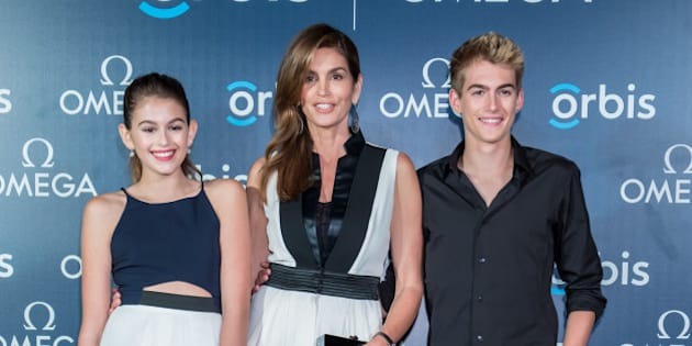 HONG KONG - JUNE 16:  Supermodel and OMEGA Ambassador Cindy Crawford poses with her daughter Kaia Gerber, and son Presley Gerber as they attend 'The Hospital In The Sky' Asian premiere presented by OMEGA on June 16, 2015 in Hong Kong, Hong Kong.  (Photo by Anthony Kwan/Getty Images for Omega)