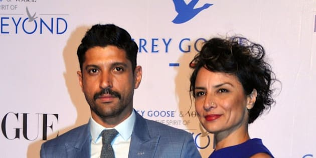 Indian Bollywood actor Farhan Akhtar (L) poses with his wife actress Adhuna Akhtar during the Grey Goose Fly Beyond Awards ceremony in Mumbai late November 16, 2014. AFP PHOTO/STR        (Photo credit should read STRDEL/AFP/Getty Images)