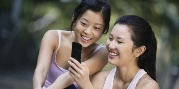 Young Women Using a Cell Phone