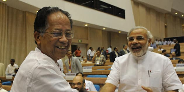 India's Gujarat state Chief Minister Narendra Modi (R) shakes hands with Assam state Chief Minister Tarun Gogoi (L) during the inauguration of the Joint Conference of Chief Ministers of the States and Chief Justices of the High Courts in New Delhi on August 16, 2009. While speaking at the Joint Conference of Chief Ministers and Chief Justices Indian Prime Minister Manmohan Singh said that the elimination of vast number of pending cases in the Indian Courts is the biggest challenge before the judiciary and called upon the judiciary and executive to work together to make the Indian judicial system an arrear free. AFP PHOTO/ Prakash SINGH (Photo credit should read PRAKASH SINGH/AFP/Getty Images)