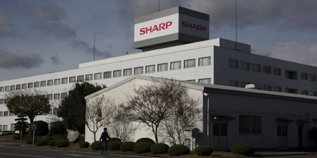 A man walks past the Sharp Corp. plant in Yaita, Tochigi Prefecture, Japan, on Thursday, Nov. 19, 2015. Shares rose as much as 7.1 percent in early Tokyo trading Nov. 20, rising for the second day, bringing the biggest two-day gain since July 3. Photographer: Tomohiro Ohsumi/Bloomberg via Getty Images