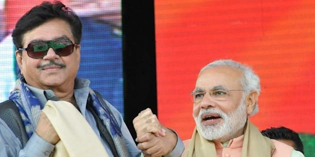 PATNA, INDIA - OCTOBER 27: Gujarat CM and BJP's prime ministerial candidate Narendra Modi with Shatrughan Sinha, former Bollywood actor and politician at the Hunkar rally on October 27, 2013 in Patna, India. The rally was preceded by a series of low-intensity blasts in the Bihar capital. One man was killed and five people were wounded in the blasts that occurred shortly before Modi arrived in Patna to launch the campaign. (Photo by AP Dube/Hindustan Times via Getty Images)