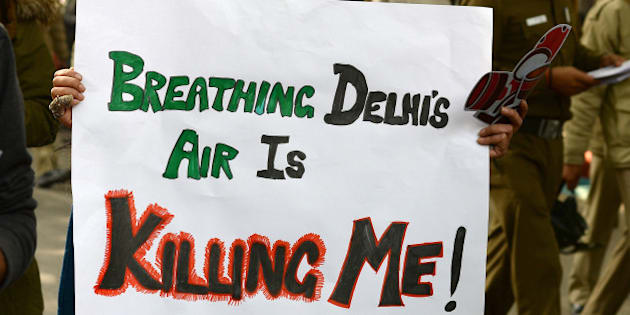 Social activists hold placards during an awareness rally against air pollution under the banner, 'Help Delhi Breathe' in New Delhi on January 17, 2016.  Dozens of Delhi residents took part in the rally to raise awareness about the harmful impact of Delhi's air and push for solutions.  AFP PHOTO / SAJJAD HUSSAIN / AFP / SAJJAD HUSSAIN        (Photo credit should read SAJJAD HUSSAIN/AFP/Getty Images)