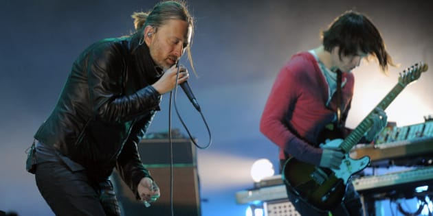 Thom Yorke, left, and Jonny Greenwood of Radiohead perform during the band's headlining set on the first weekend of the 2012 Coachella Valley Music and Arts Festival, Saturday, April 14, 2012, in Indio, Calif. (AP Photo/Chris Pizzello)