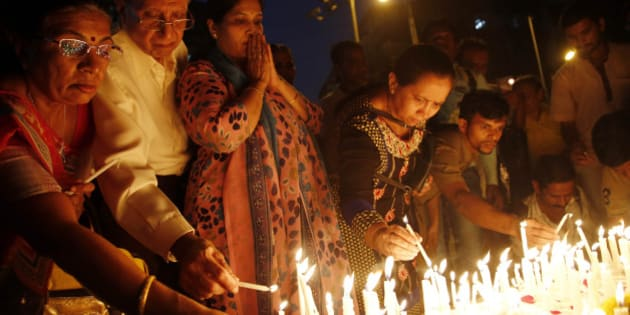 Indians light candles as they pay tribute to Indian soldiers killed in the Pathankot air base attack, in Mumbai, India, Wednesday, Jan 6, 2016. Indian forces have killed the last of the six militants who attacked an air force base near the Pakistan border over the weekend, the defense minister said Tuesday, though soldiers were still searching the base as a precaution.(AP Photo/Rajanish Kakade)