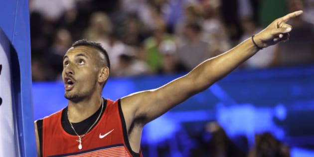 Nick Kyrgios of Australia gestures as he argues with the umpire during his third round match against  Tomas Berdych of the Czech Republic at the Australian Open tennis championships in Melbourne, Australia, Friday, Jan. 22, 2016.(AP Photo/Aaron Favila)