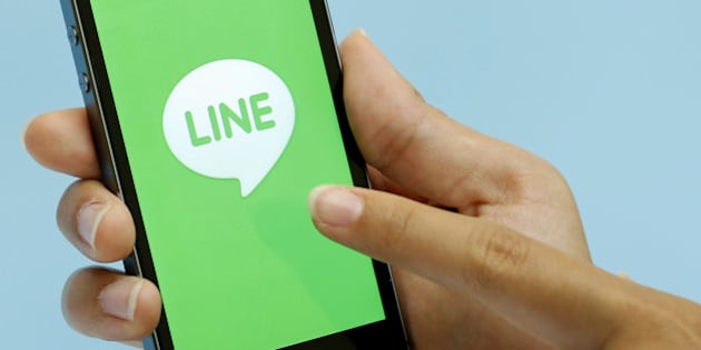 The loading page for a messaging and calling service application operated by Line Corp., controlled by Naver Corp., is displayed on an Apple Inc. iPhone 5s for a photograph during an event for the company's new services in Tokyo, Japan, on Wednesday, Aug. 27, 2014. Line will offer a group discount service from Aug. 28 in Japan, Takeshi Shimamura, an executive director at the company, told reporters in Tokyo today. Photographer: Kiyoshi Ota/Bloomberg via Getty Images