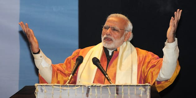 LUCKNOW, INDIA - JANUARY 22: Prime Minister Narendra Modi speaks during the convocation of the Babasaheb Bhimrao Ambedkar University on January 22, 2016 in Lucknow, India. Prime Minister Narendra Modi paid an emotional tribute to a young scholar from India's lowest Dalit caste who committed suicide last week, a death some have blamed on social discrimination.(Photo by Ashok DuttaHindustan Times via Getty Images).